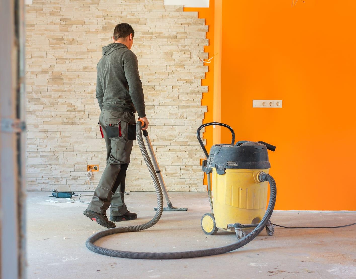 person using wet/dry vacuum