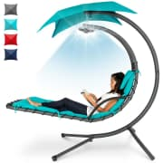 """Hanging LED-Lit Curved Chaise Lounge Chair. Apply coupon code """"LOUNGE30"""" to drop it to $219.99, a savings of $80 off list."""