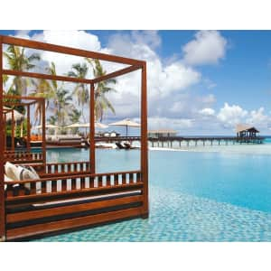 5-Night Beach Villa Stay at 5-Star Maldives Retreat w/ Dolphin Cruise through Dec. '22 at Travelzoo: for $1,699 for 2