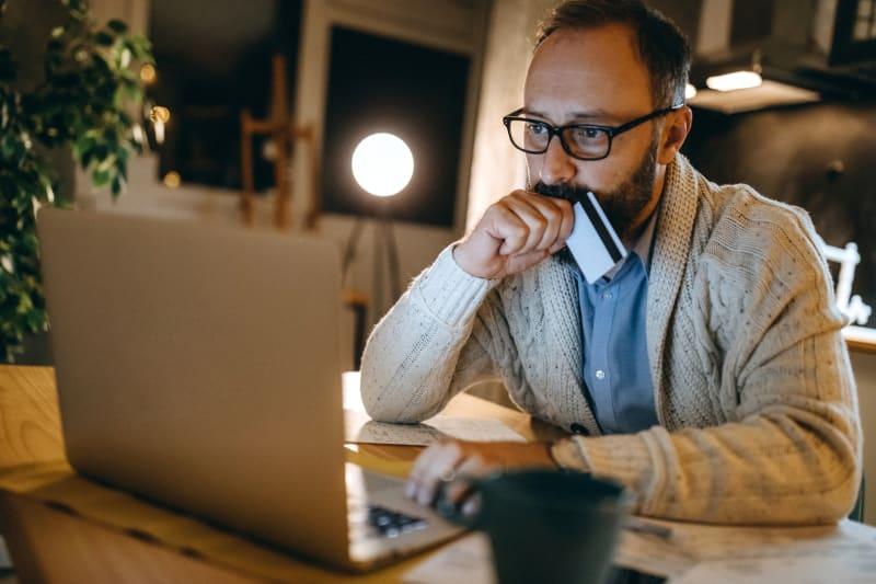 man paying bills online