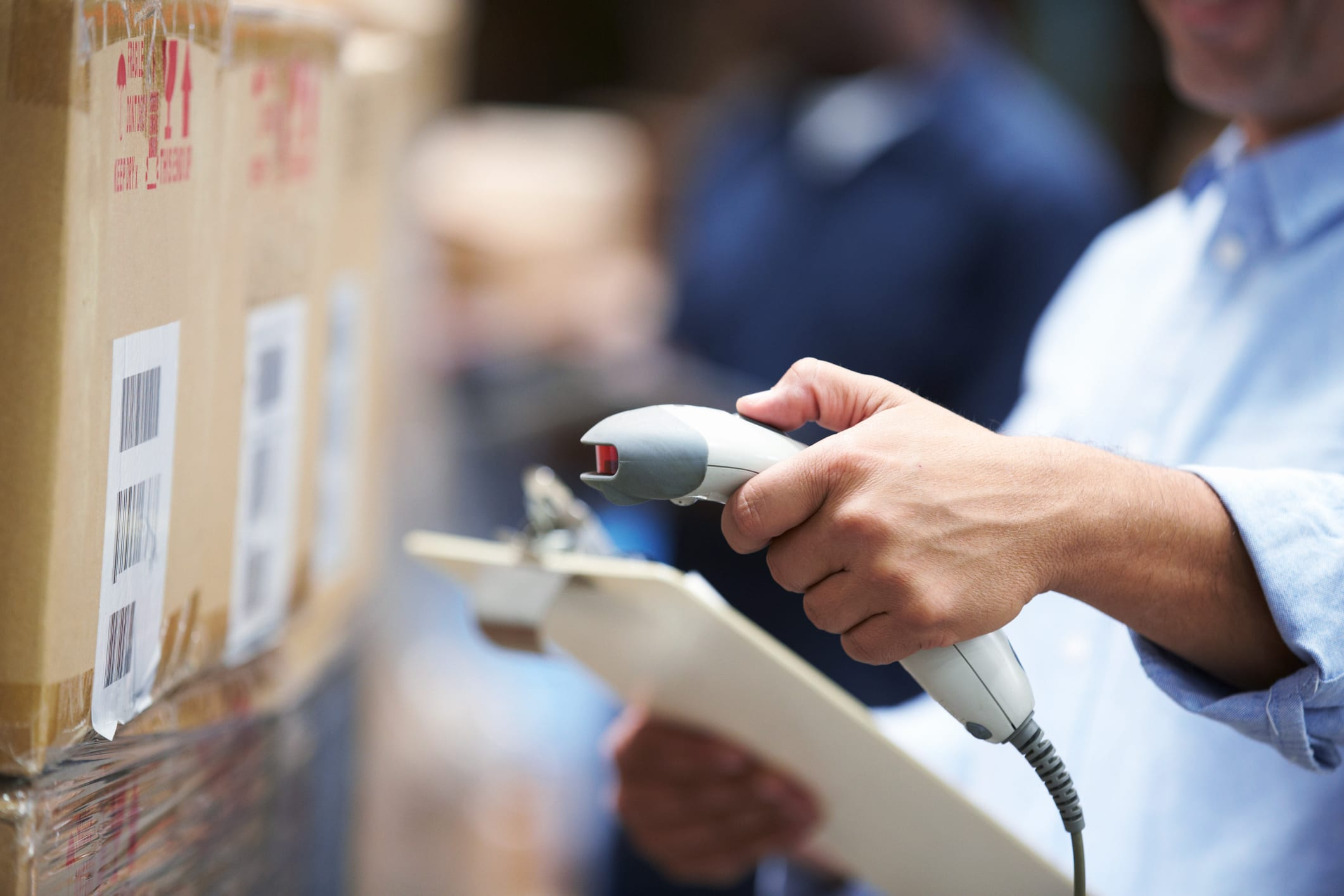 man scans warehouse package