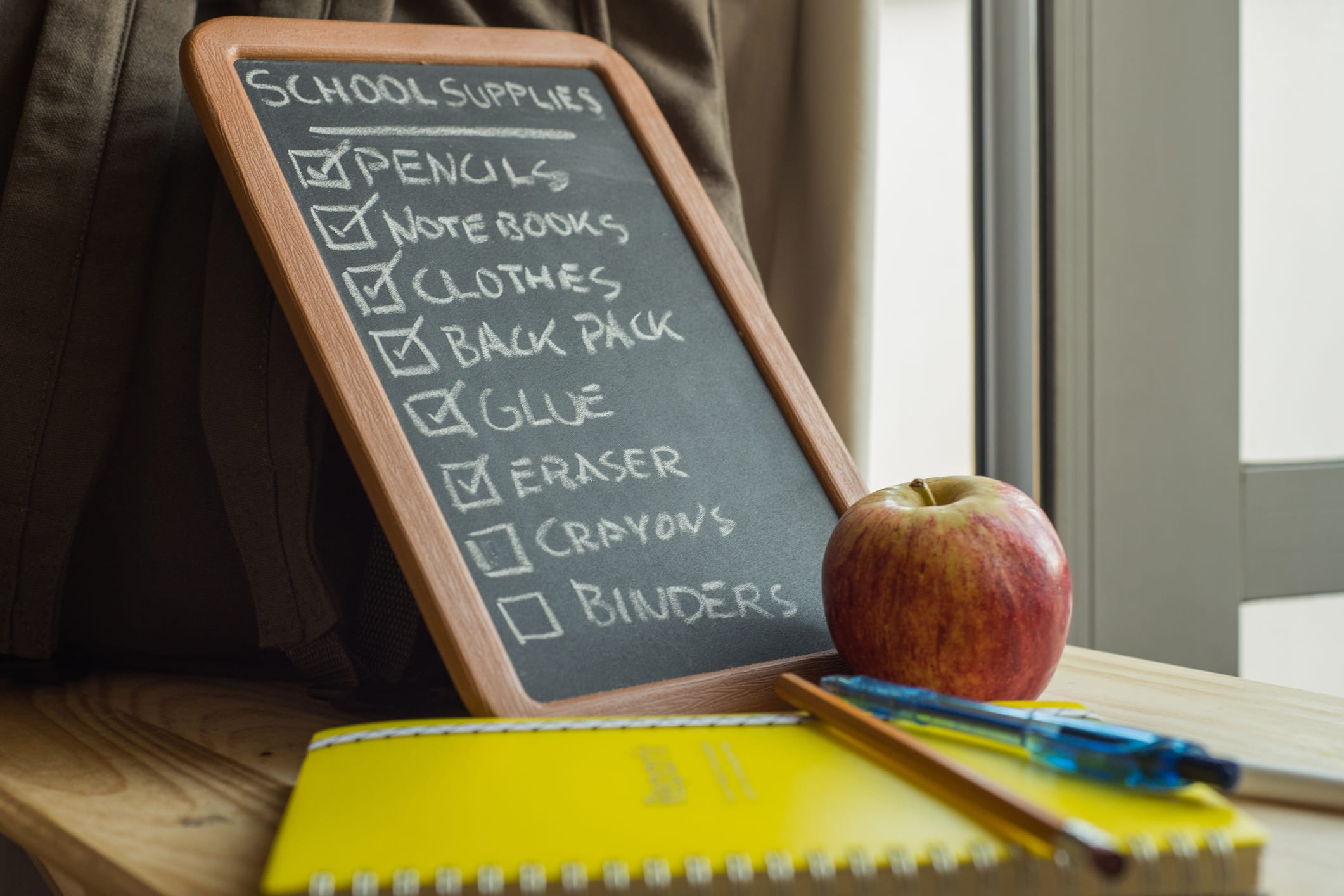 school supply list on chalkboard