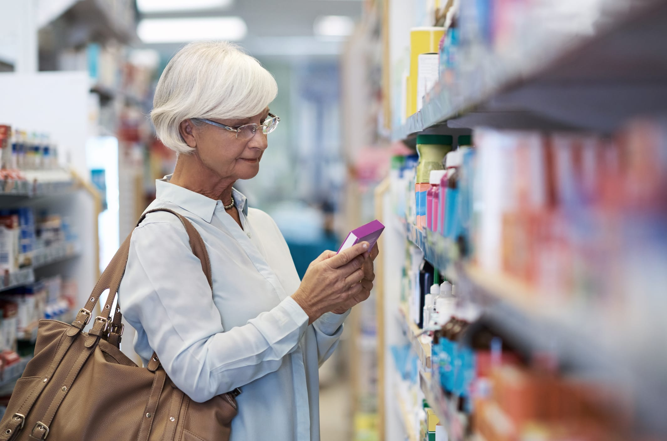 Woman shopping for over-the-counter drugs