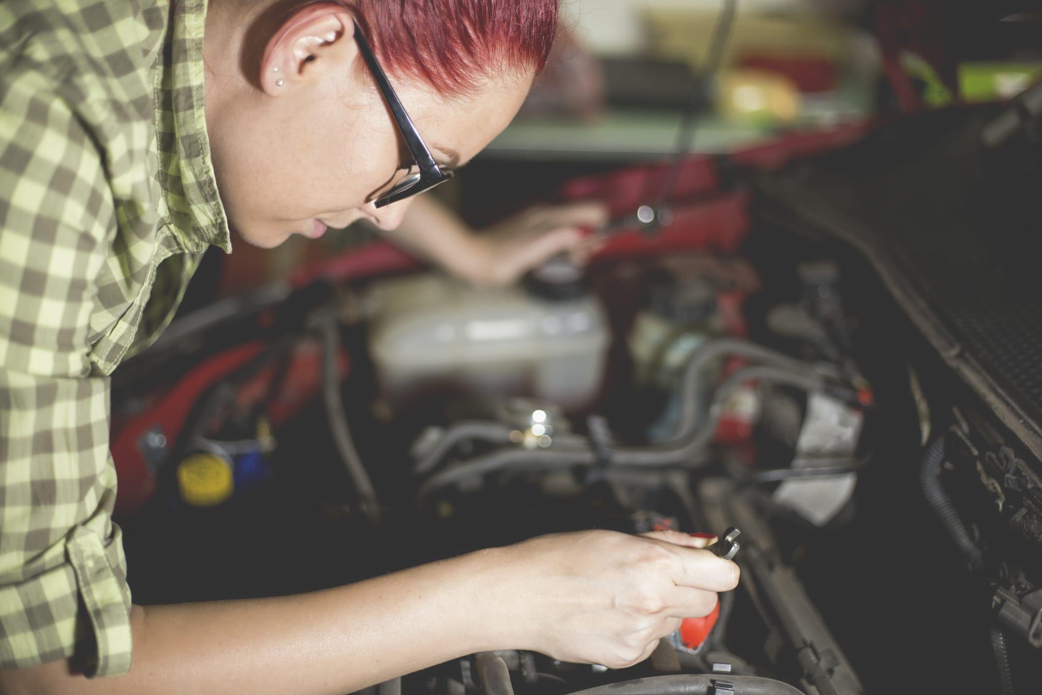 Woman Repairing Car