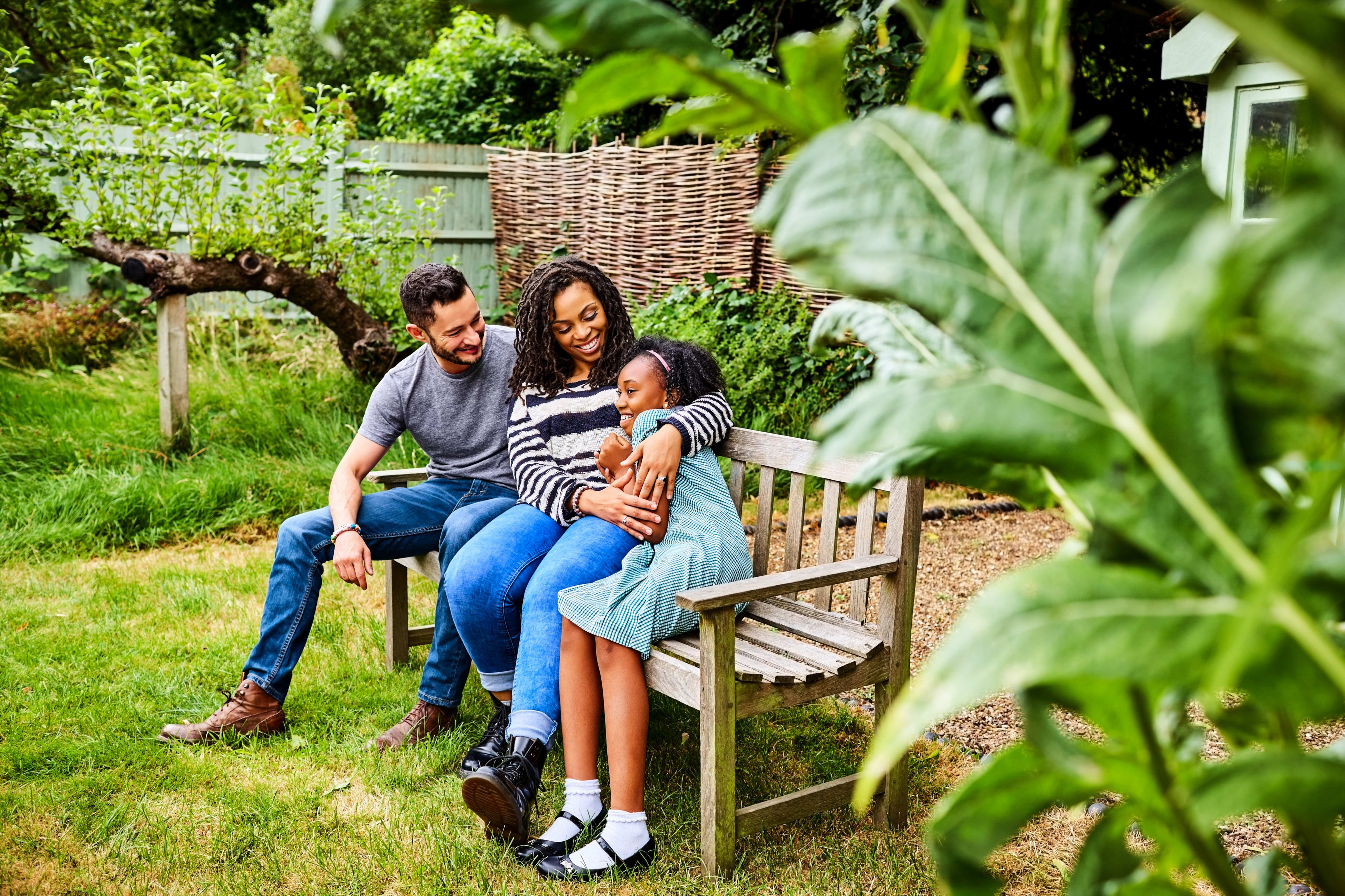 happy family sits on bench