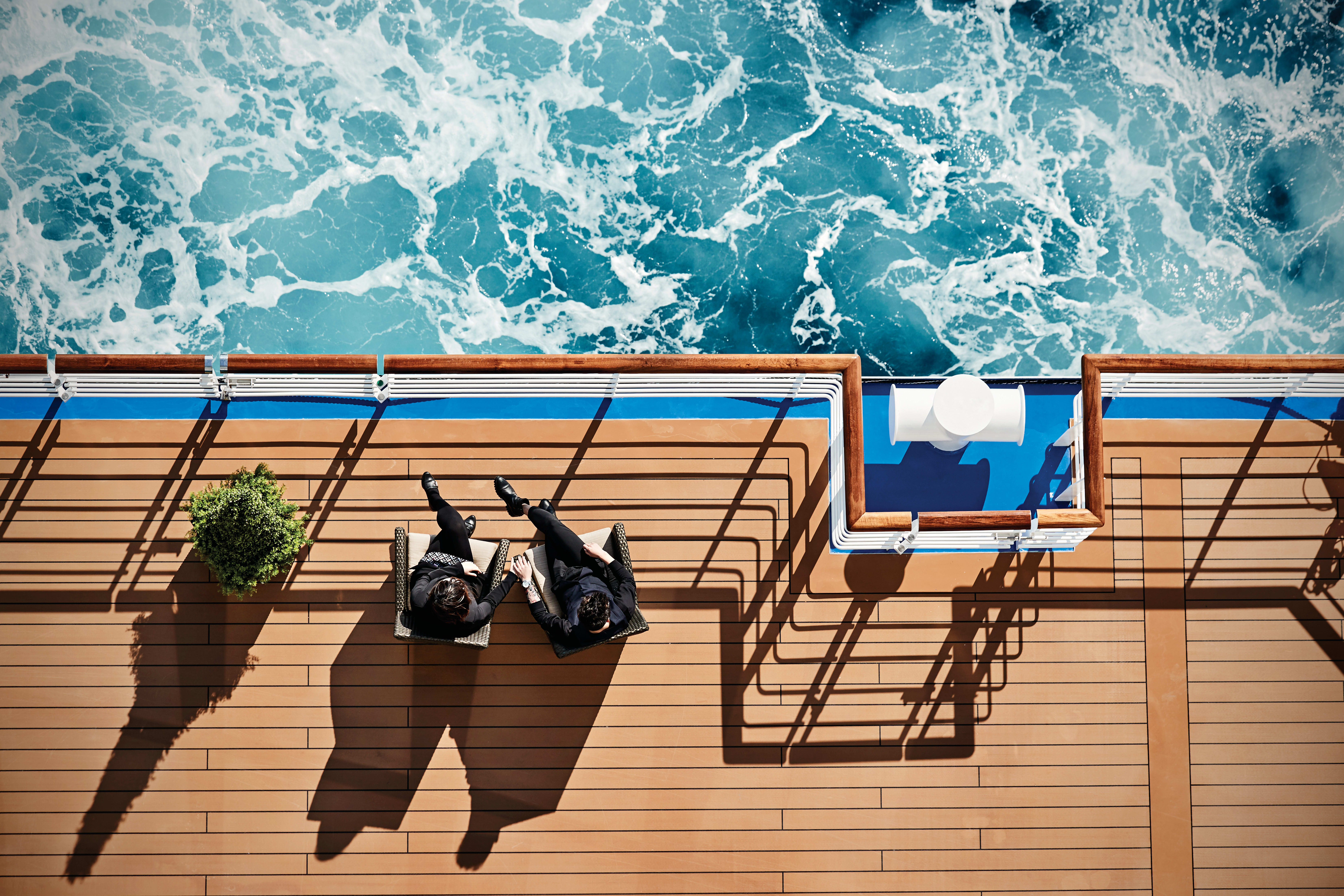couple with deck chairs