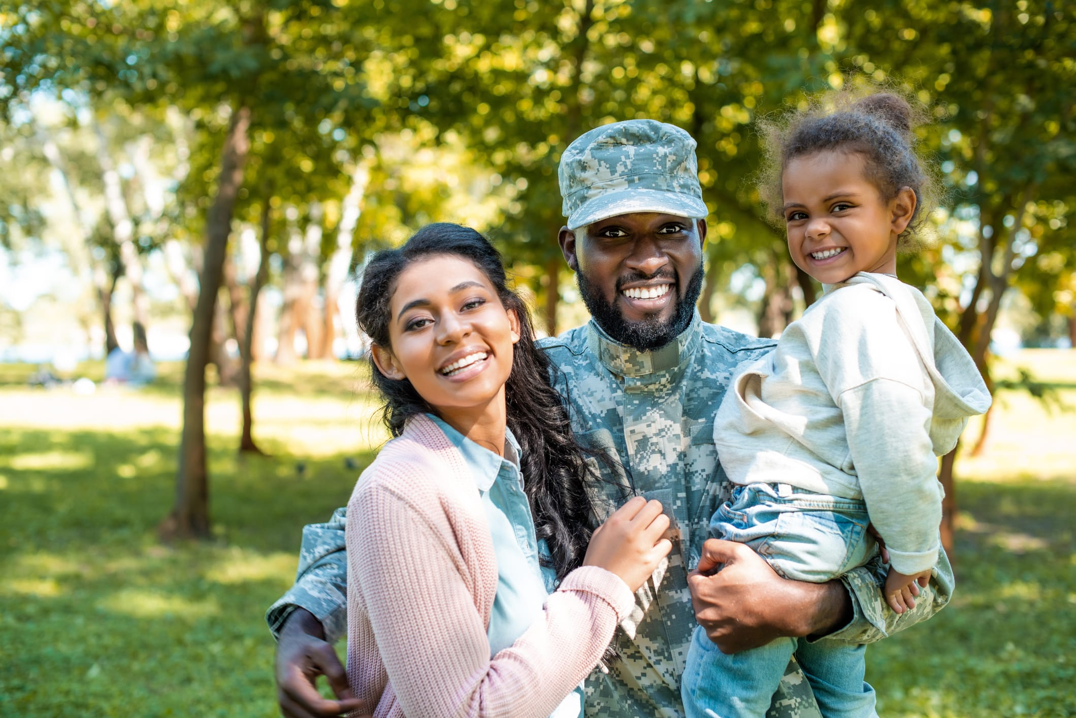 happy military family in park