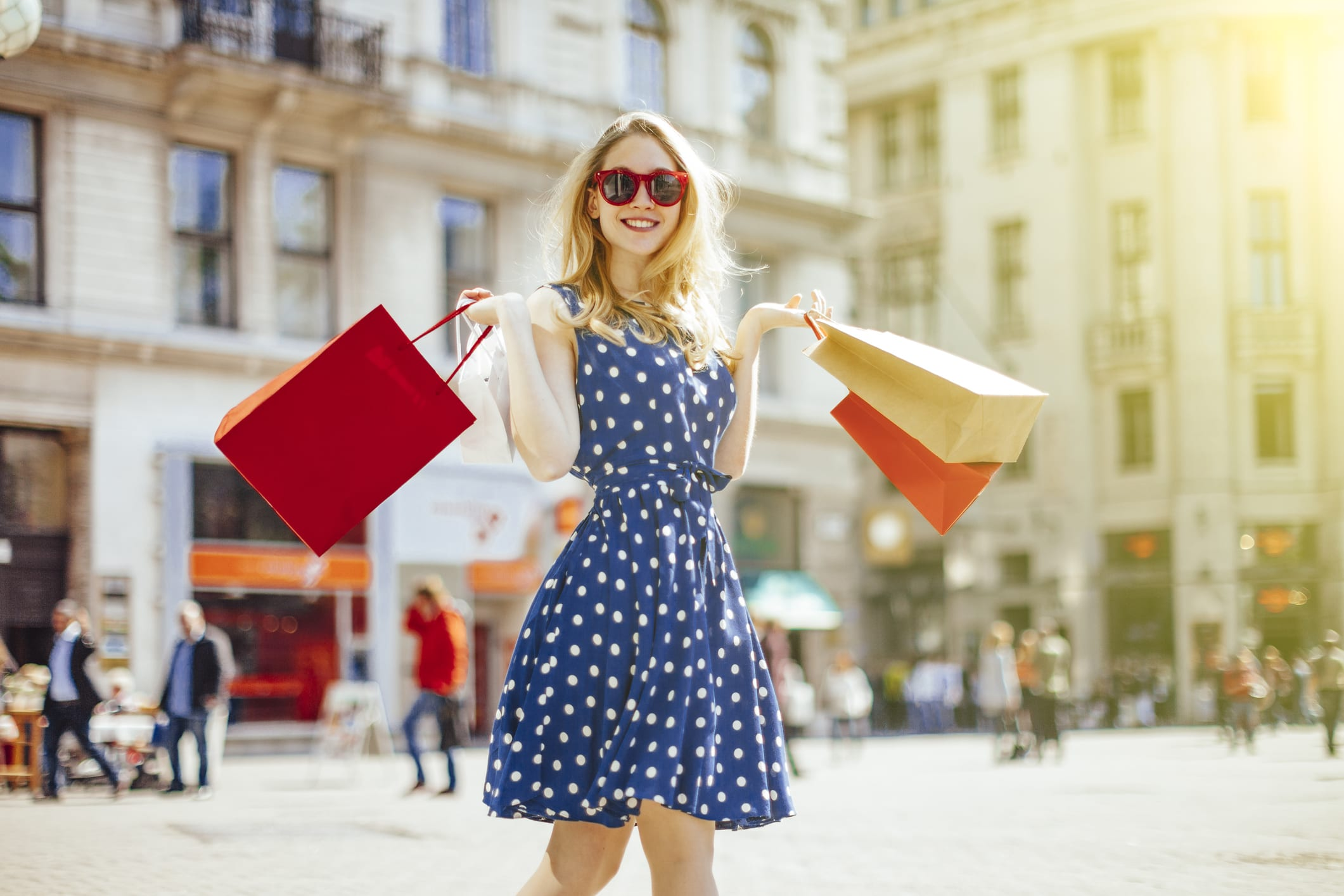 woman holding shopping bags outside