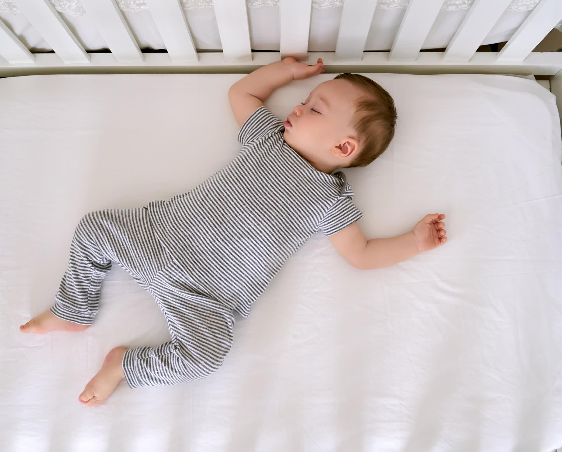 baby sleeps on mattress