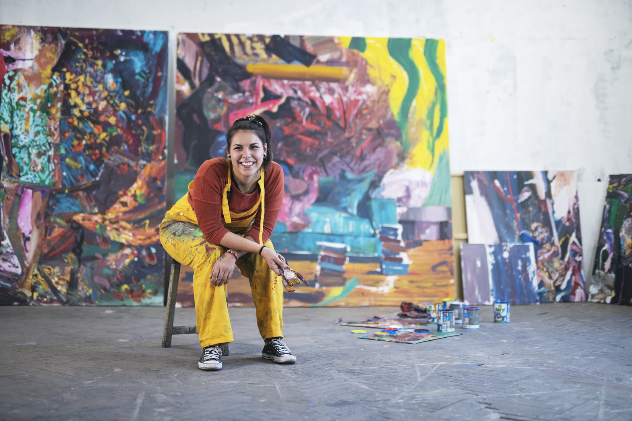 woman artist with paintings